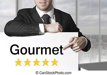 businessman pointing on sign gourmet five star rating -...