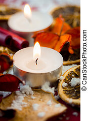 Christmas tea light candle with dried fruits