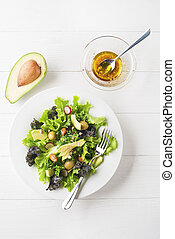 Salad with avocado - Fresh mixed green salad with avocado on...