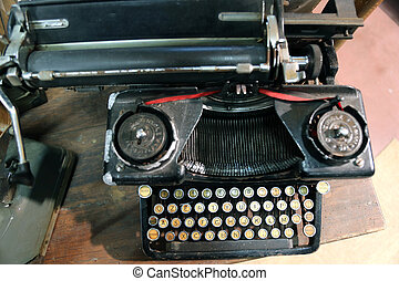 black rusty typewriter used by typists than once - ancient...