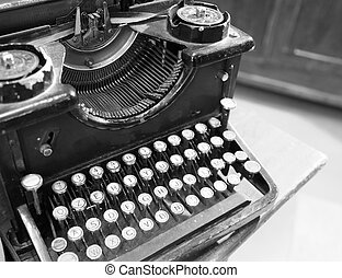 ancient black rusty typewriter used by typists - black rusty...