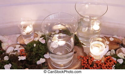 Burning candles in water glass - Group of burning candles...