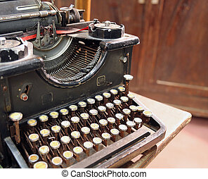 black rusty typewriter with round keys - ancient black rusty...