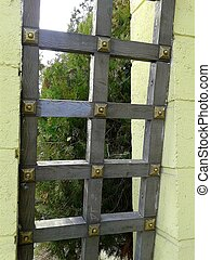 wooden lattice - a large wooden gate in a grid with metallic...
