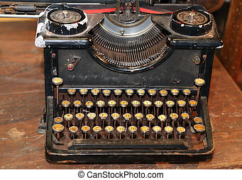ancient black rusty typewriter used by typists than once -...