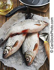 Rudd, ide - Fresh fish rudd, ide on a wooden table