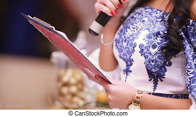 Leading ceremony - Sheet with text wedding ceremony in hands...