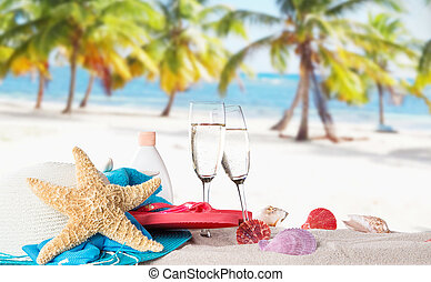 Champagne flutes on sunny beach, celebration theme