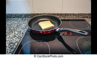Time lapse of sandwich mount and cook process in a pan over...