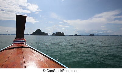azure water sea - longtail Boat sailing to the islands in...