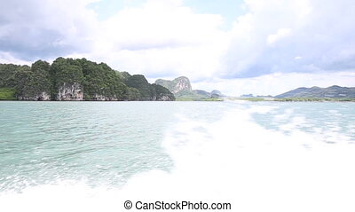 azure water sea and rock mountains