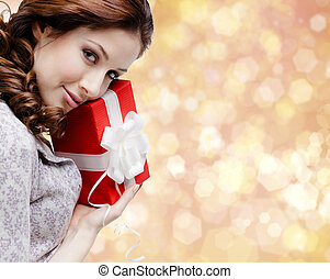 Young woman is satisfied with a christmas gift