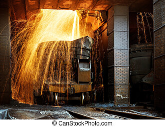Smelter - Liquid iron from ladle in the steelworks