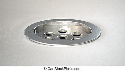 Round Plug Hole Closeup - A closeup of a chrome plug hole...