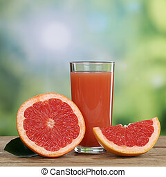 Grapefruit juice and fresh grapefruits fruits in summer