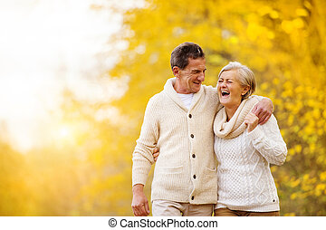 Active seniors walk in nature - Active seniors having fun...