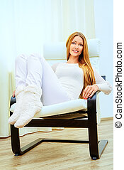 householder - Happy young woman resting at home in a...