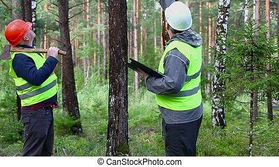Forest Officer with worker in forest