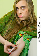 She is alone at home with drugs - Drugs - young woman posing...