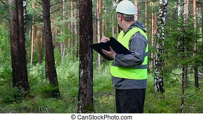 Forest Officer inspect forest