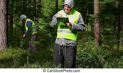Forest Officer with workers behaind