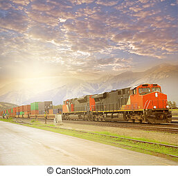 Freight train in Canadian rockies at sunset Jasper Alberta...