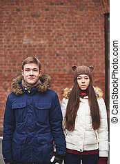 Couple in winterwear - Portrait of young dates in winterwear...