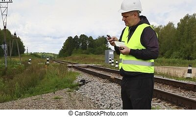 Railroad maintenance worker with cell phone