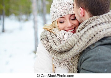 Happy woman - Woman embracing with her boyfriend in winter