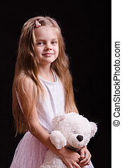 Five-year girl with a teddy bear