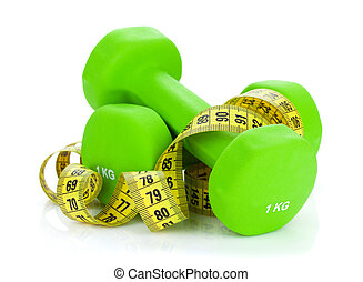 Two green dumbells and tape measure. Fitness and health....