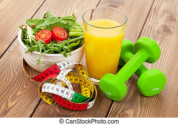 Dumbells, tape measure and healthy food. Fitness and health...