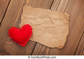 Blank old piece of paper and vintage handmaded valentines...