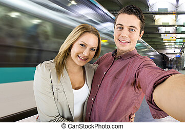 Subway Selfie - Young couple taking a selfie while waiting...
