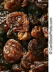 dried raisin macro texture in a close up crop. atural fruits...