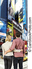 Couple looking at billboards - Young couple in a big city,...