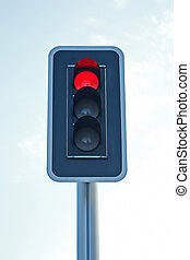 Red traffic light - Closeup of a red traffic light with blue...