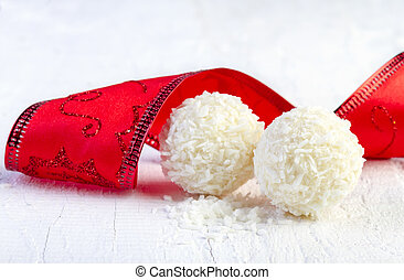 Coconut snowball truffles on white background. Arrangement...
