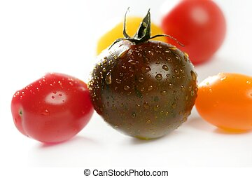 Little cherry varied multi color tomatoes, at studio, white...