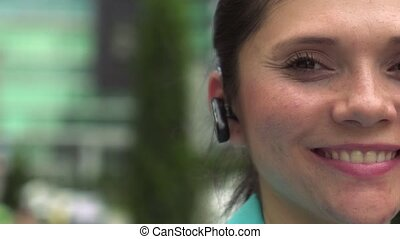 Businesswoman with bluetooth device - Hispanic woman,...