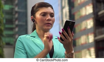 Female manager making a phone call - Latina businesswoman...