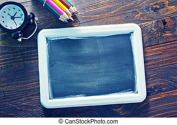 black board and color pencils on a table