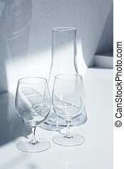 Water glass and bottle with transparent shadows