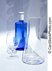 Blue water bottle with glass, transparent shadow