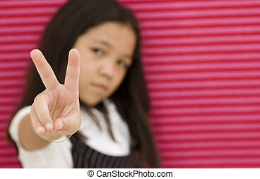 Asian Girl Giving Peace Sign Against Paper Background