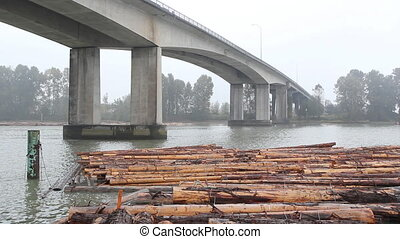 Knight Street Bridge and lumber. - Lumber in the Fraser...
