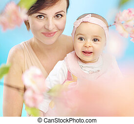 Pretty mother with cute child - Pretty mother with cute...