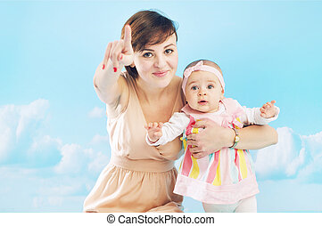 Young mom playing with her daughter
