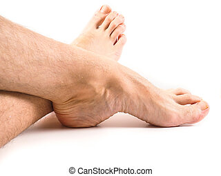Hairy legs and feet of male person resting towards white...