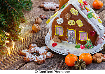 gingerbread house with tangerines and christmas lights
